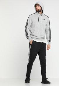 adidas Performance - MUST HAVES SPORT TIRO SLIM FIT PANT - Pantalon de survêtement - black/white - 1