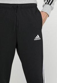 adidas Performance - MUST HAVES SPORT TIRO SLIM FIT PANT - Jogginghose - black/white - 4