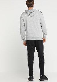 adidas Performance - MUST HAVES SPORT TIRO SLIM FIT PANT - Pantalon de survêtement - black/white - 2