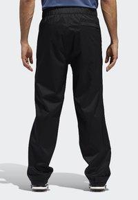 adidas Golf - CLIMAPROOF - Pantalones deportivos - black - 1