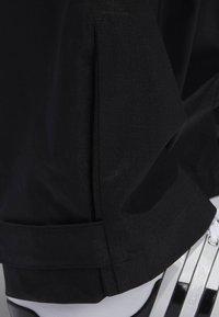 adidas Golf - CLIMAPROOF - Pantalones deportivos - black - 5