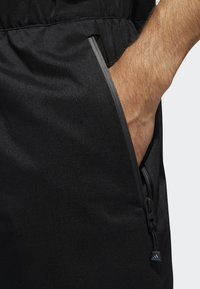 adidas Golf - CLIMAPROOF - Pantalones deportivos - black - 4
