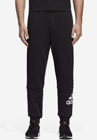 adidas Performance - MUST HAVES SPORT TAPERED SWEAT PANT - Tracksuit bottoms - black - 0