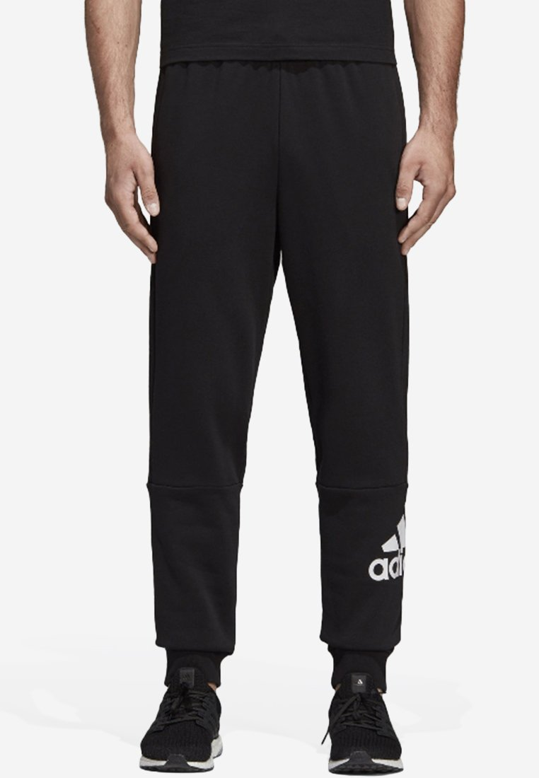 adidas Performance - MUST HAVES SPORT TAPERED SWEAT PANT - Tracksuit bottoms - black