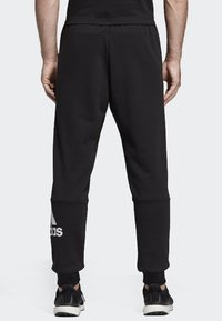 adidas Performance - MUST HAVES SPORT TAPERED SWEAT PANT - Tracksuit bottoms - black - 1