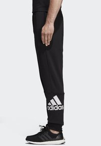 adidas Performance - MUST HAVES SPORT TAPERED SWEAT PANT - Tracksuit bottoms - black - 2