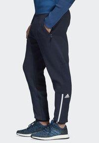 adidas Performance - ADIDAS Z.N.E. PRIMEKNIT PANTS - Trainingsbroek - blue - 5