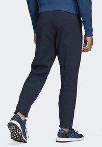 adidas Performance - ADIDAS Z.N.E. PRIMEKNIT PANTS - Trainingsbroek - blue - 1
