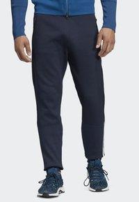 adidas Performance - ADIDAS Z.N.E. PRIMEKNIT PANTS - Trainingsbroek - blue - 0