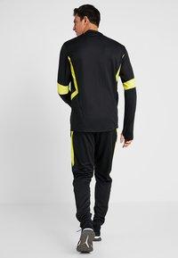 adidas Performance - Manchester United - Teplákové kalhoty - black/solar grey - 2