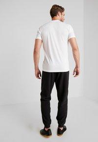 adidas Performance - MUFC - Träningsbyxor - black - 2