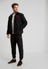 adidas Performance - MUFC - Träningsbyxor - black - 1