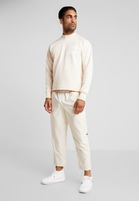 adidas Performance - PANT - Joggebukse - off-white - 1