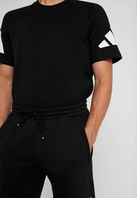 adidas Performance - ATHLETICS PACK SPORT TAPERED SWEAT PANT - Pantalones deportivos - black - 3