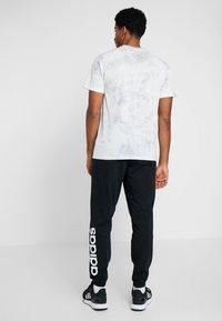 adidas Performance - Teplákové kalhoty - black/white - 2