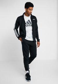 adidas Performance - Teplákové kalhoty - black/white - 1