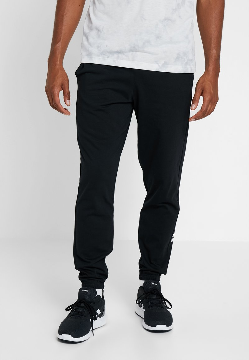 adidas Performance - Tracksuit bottoms - black/white