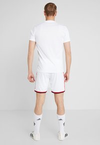adidas Performance - AJAX AMSTERDAM H SHO - Sports shorts - white/bold red/black - 2