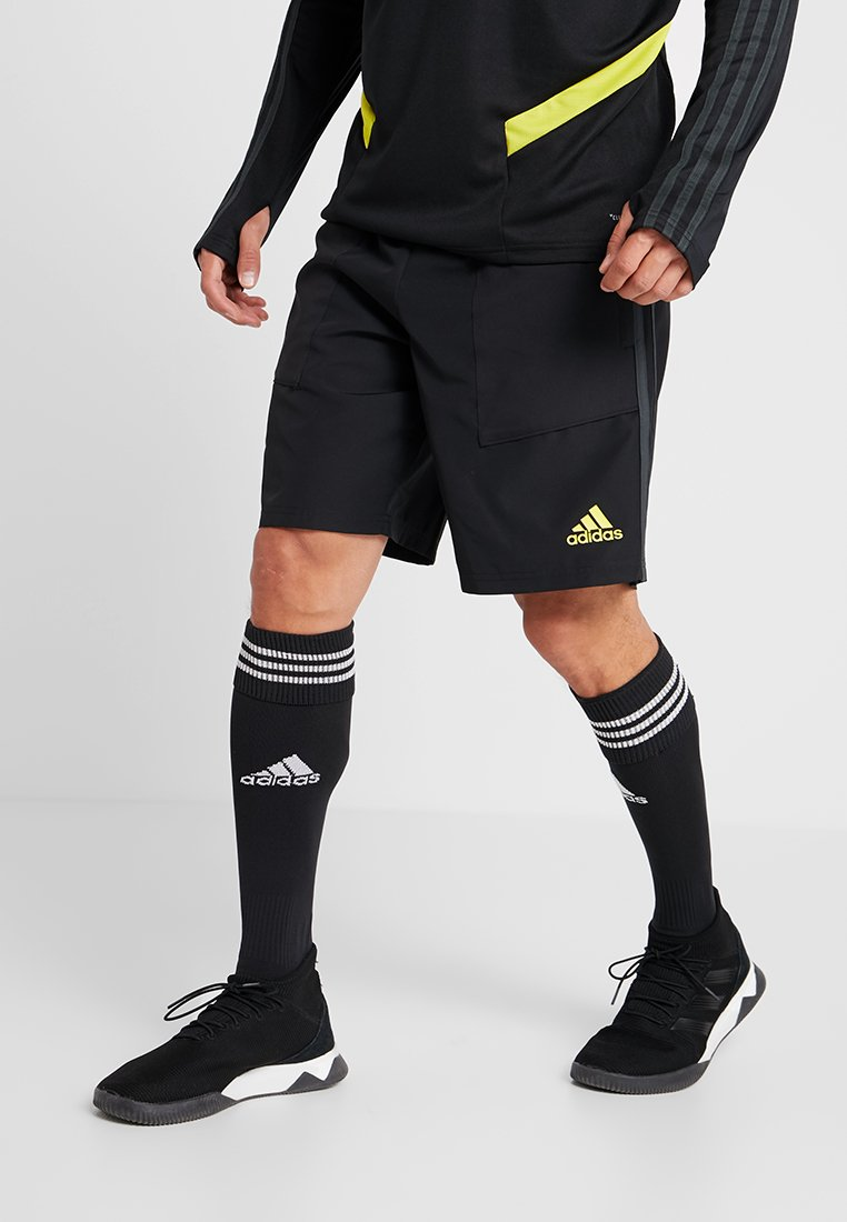 adidas Performance - MANCHESTER UNITED FC - kurze Sporthose - black/green