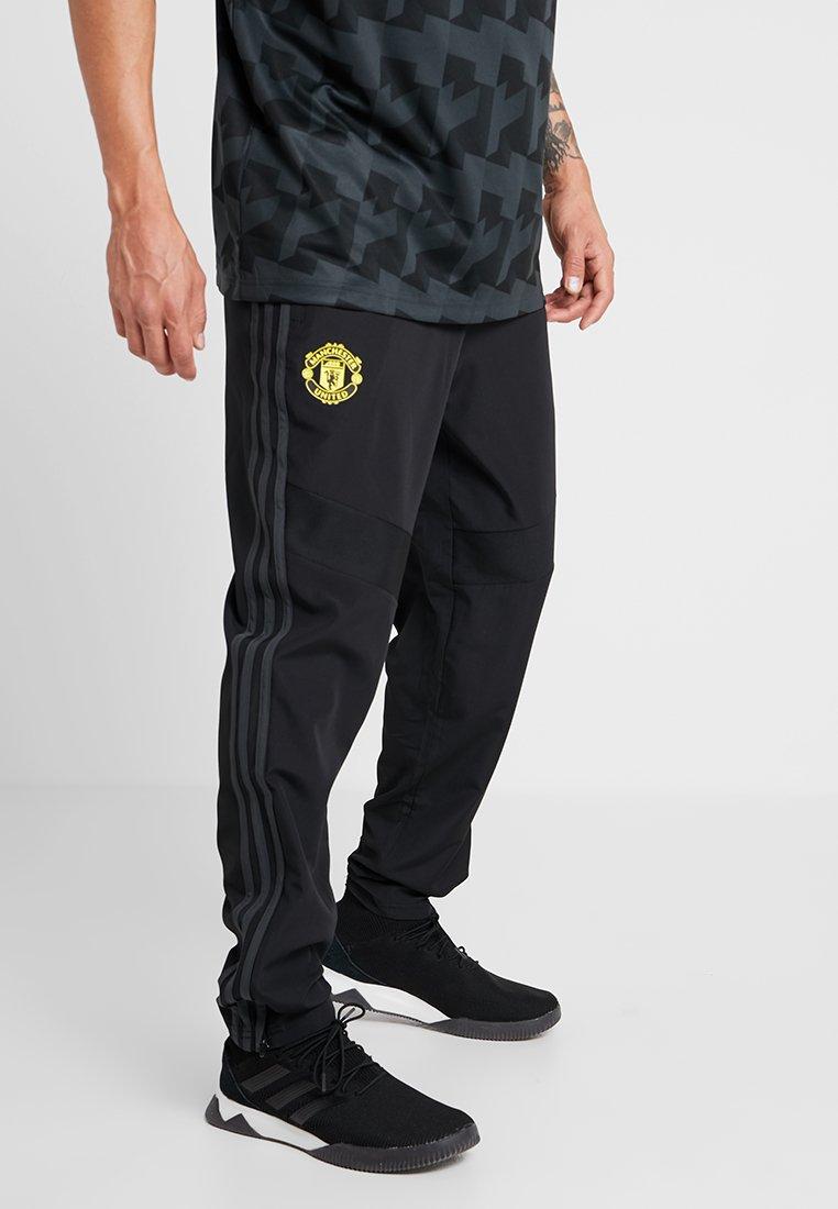 adidas Performance - MANCHESTER UNITED FC - Träningsbyxor - black/green