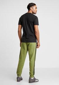 adidas Performance - Trainingsbroek - tecoli/black - 2