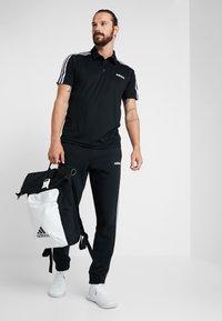adidas Performance - Tracksuit bottoms - black/white - 1