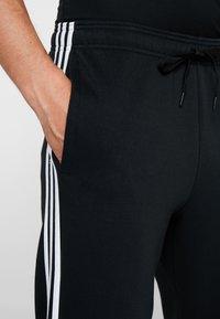 adidas Performance - Verryttelyhousut - black/white - 3