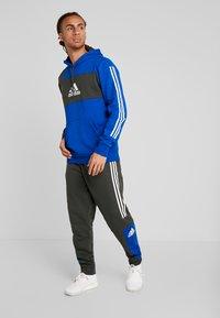 adidas Performance - SPORT ID TAPERED PANT - Trainingsbroek - legear/croyal - 1
