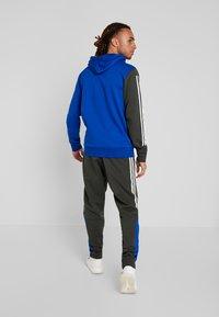 adidas Performance - SPORT ID TAPERED PANT - Trainingsbroek - legear/croyal - 2