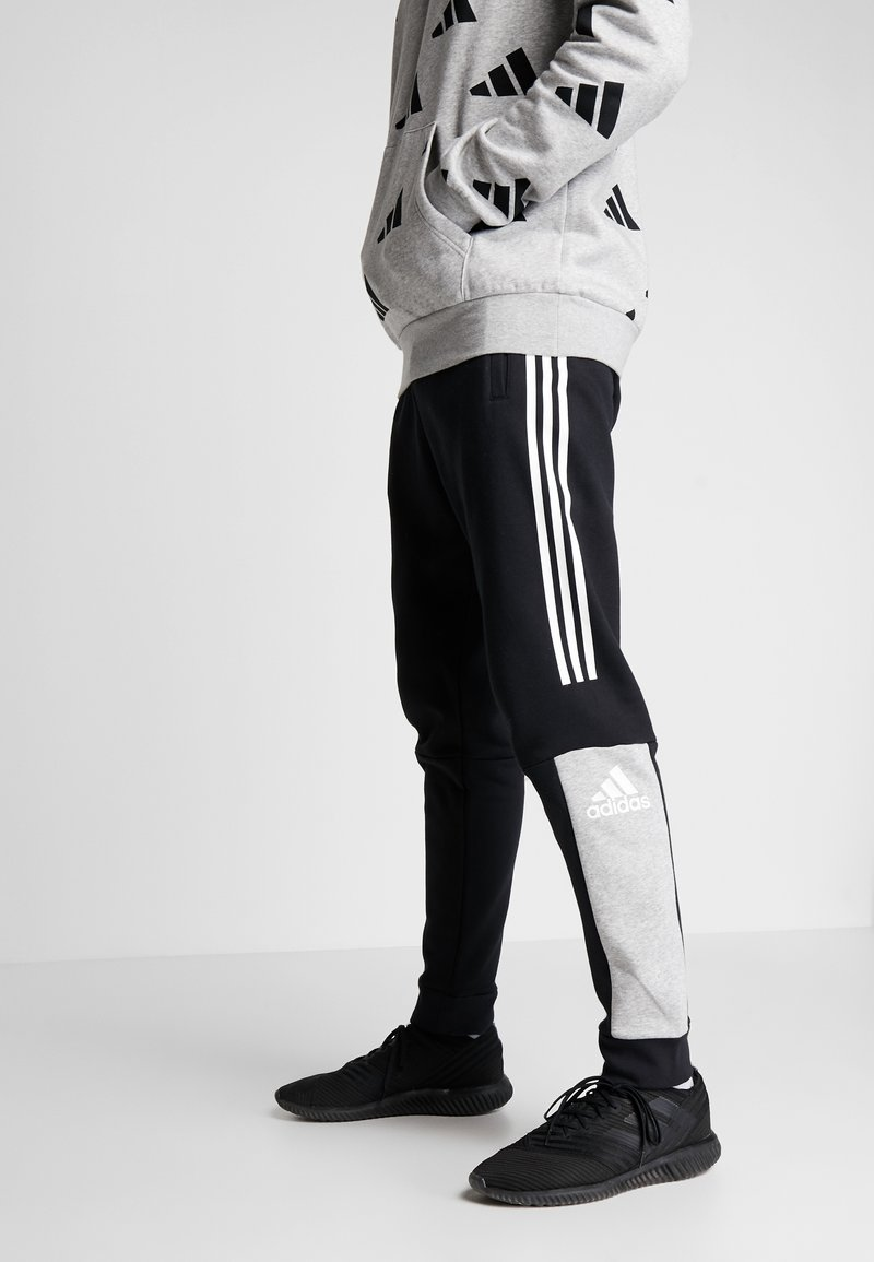 adidas Performance - SPORT ID TAPERED PANT - Träningsbyxor - black