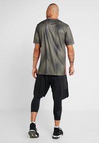 adidas Performance - TAN SHONT - Sports shorts - black - 2