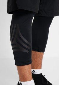 adidas Performance - TAN SHONT - Sports shorts - black - 5