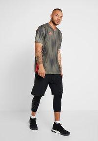 adidas Performance - TAN SHONT - Sports shorts - black - 1