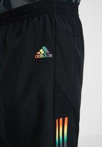 adidas Performance - OWN THE RUN - Pantalón corto de deporte - black - 4