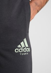adidas Performance - CAT PANT - Tracksuit bottoms - carbon - 3