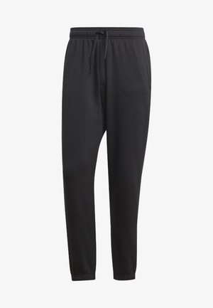 ESSENTIALS LINEAR TAPERED PANTS - Spodnie treningowe - black