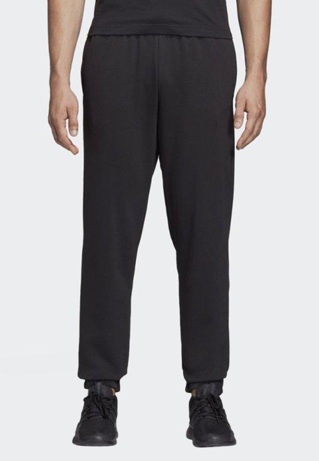ESSENTIALS LINEAR TAPERED PANTS - Spodnie treningowe - black