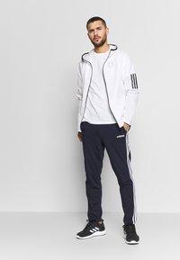 adidas Performance - ESSENTIALS 3-STRIPES TAPERED OPEN HEM PANTS - Pantalones deportivos - legend ink/white - 1