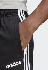 adidas Performance - ESSENTIALS 3-STRIPES TAPERED OPEN HEM PANTS - Pantalones deportivos - black - 2