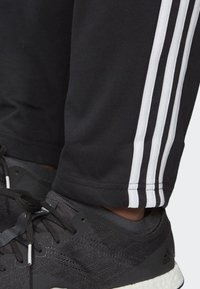 adidas Performance - ESSENTIALS 3-STRIPES TAPERED OPEN HEM PANTS - Pantalones deportivos - black - 3