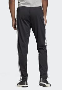 adidas Performance - ESSENTIALS 3-STRIPES TAPERED OPEN HEM PANTS - Pantalones deportivos - black - 1