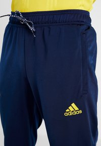 adidas Performance - ARSENAL FC ICONS - Tracksuit bottoms - dark blue - 5