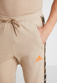 adidas Performance - Pantalon de survêtement - tan - 3