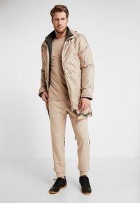 adidas Performance - Pantalon de survêtement - tan - 1