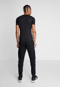 adidas Performance - SID - Pantalon de survêtement - black - 2