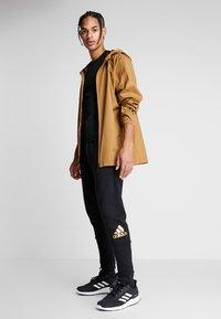 adidas Performance - SID - Pantalon de survêtement - black - 1