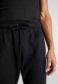 adidas Performance - SID - Tracksuit bottoms - black - 5