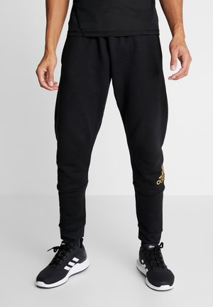 SID - Tracksuit bottoms - black