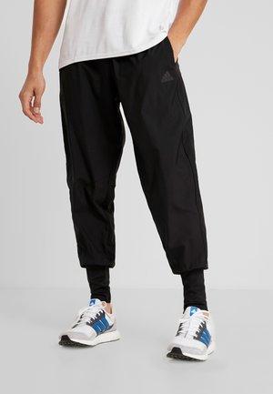 ASTRO PANT  - Pantalones deportivos - black