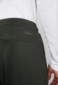 adidas Performance - Sports shorts - green - 4